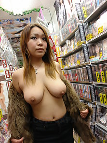 Japanese chick Nami Misa shows big breasts in a sex shop