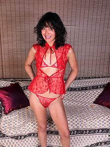 Petite cougar slips off her lingerie and stuffs a rabbit toy deep in her pussy