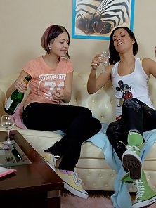 Two sweet brunettes fucking with dildos on the couch