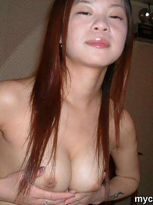 Asian amateur girl with big boobs strips and sucks a cock hard here