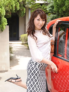 Asian chick Erika Hiramatsu posing by the car in sexy outfit