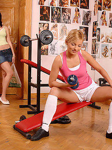 Horny girls enjoy sweaty sapphic action in the gym