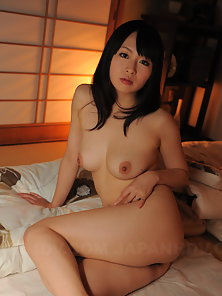 Stunning Japanese Beauty Nozomi Hazuki Plays with Her Big Boobs on Bed