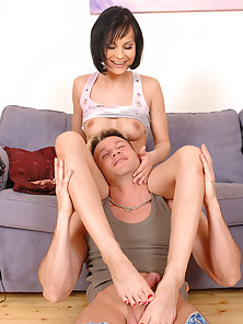 Beautiful Babe Abbie Cat Gets Seduced and Gives Footjob on Couch