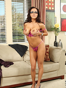 Desirable cougar in glasses strips off her office attire and flaunts her body