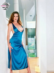 Redhead Aimee Sweet poses and strips out of sexy blue dress