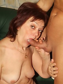 Mature Redheaded Paula Striptease and Gives Head on Webcam