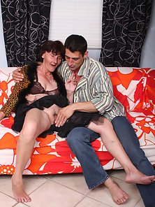 Granny Stephanie Sucking and Riding Stiff Dick of Hunky Younger Dude on Couch