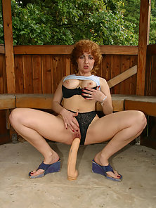 Redhead Granny having Big Tits Kneading Her Big Breasts while Cramming Big Dildo