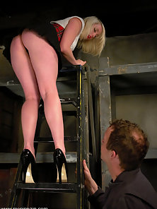 Upskirt fetish Mistress punishes slave boy