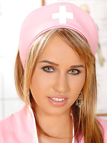 Blonde hot pink nurse Alexa plays with a vibrator