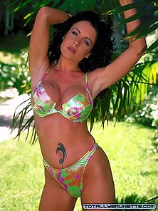 Black haired Dolphin showing her massive jugs outdoors