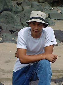 Lusty latino boy poe naked in the sea shore