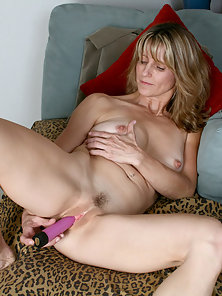 Long haired Anilos Berkley gently drills her juicy pink hole while playing with her lovely tits