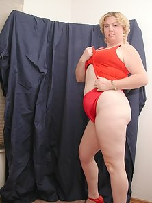 Short Haired Fat Blonde in Red Teasing and Revealing Red Panty