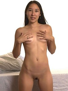 Long haired asian shows her boobs and pussy