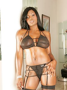 A chocolate colored cutie with massive mammaries gets nailed