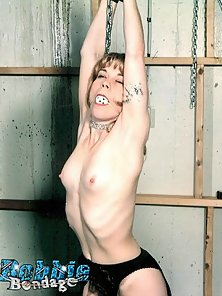 Small boobed girl tied up and having her tits flogged