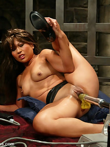 Hot Asian is machine fucked in her pussy and does two ...