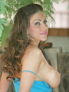 Ravenous cougar Victoria Valentino exposes her perky milf tits and pink pussy outdoors