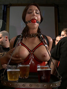 Beverly Hills gets tied up tight and fucked in a biker bar where everyone joins in