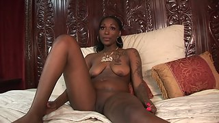 Tattooed Ebony Pussy Rubbing and Fingering over Bed for Orgasm