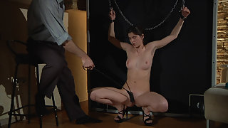 Brunette Slave with Perky Boobs and Shaved Pussy Gets Spanked by Dude