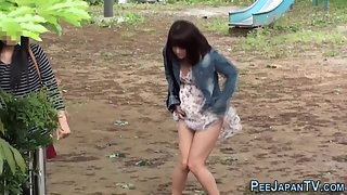 Naughty Asian Chick Peeing Outdoors and Getting Watched